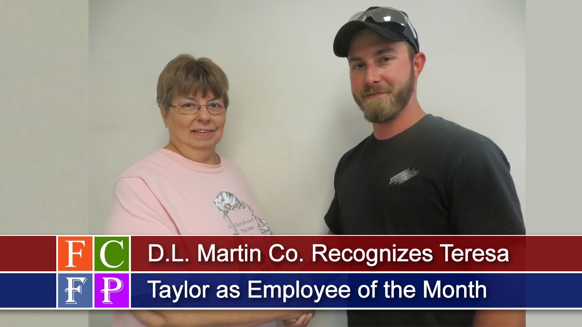 D.L. Martin Co.'s Employee of the Month Teresa Taylor (left), is congratulated by her supervisor, Dakota Carmack.